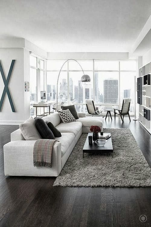 modern living room | awesome living room | glass wall | windows | floor to ceiling living room | wood floors | cityscape | urban landscape