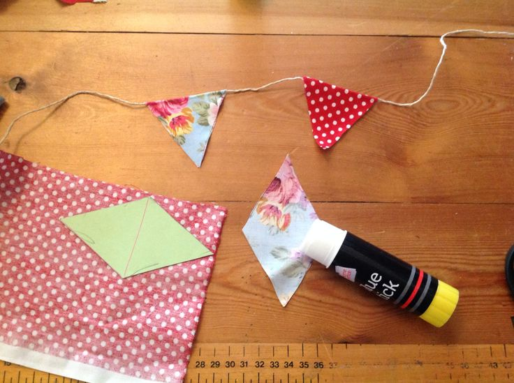 Quick and easy bunting - no sewing required! 1. Make a template of cardboard (helps to draw the pattern) 2. Cut out 3. Cover the wrong side in glue 4. Fold over string 5. Repeat until you run out of string It's as easy as that! I used little fabric scraps, there are loads of things you could use; wrapping paper, napkins, comics, newspapers, music sheets... Can you think anything else? Xx