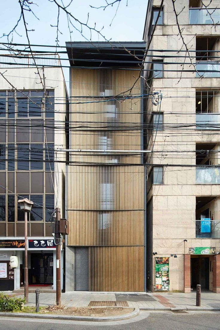 Florian Busch Architects have designed an apartment building which translates the horizontal sequence of Kyoto encounters into the vertical facade.