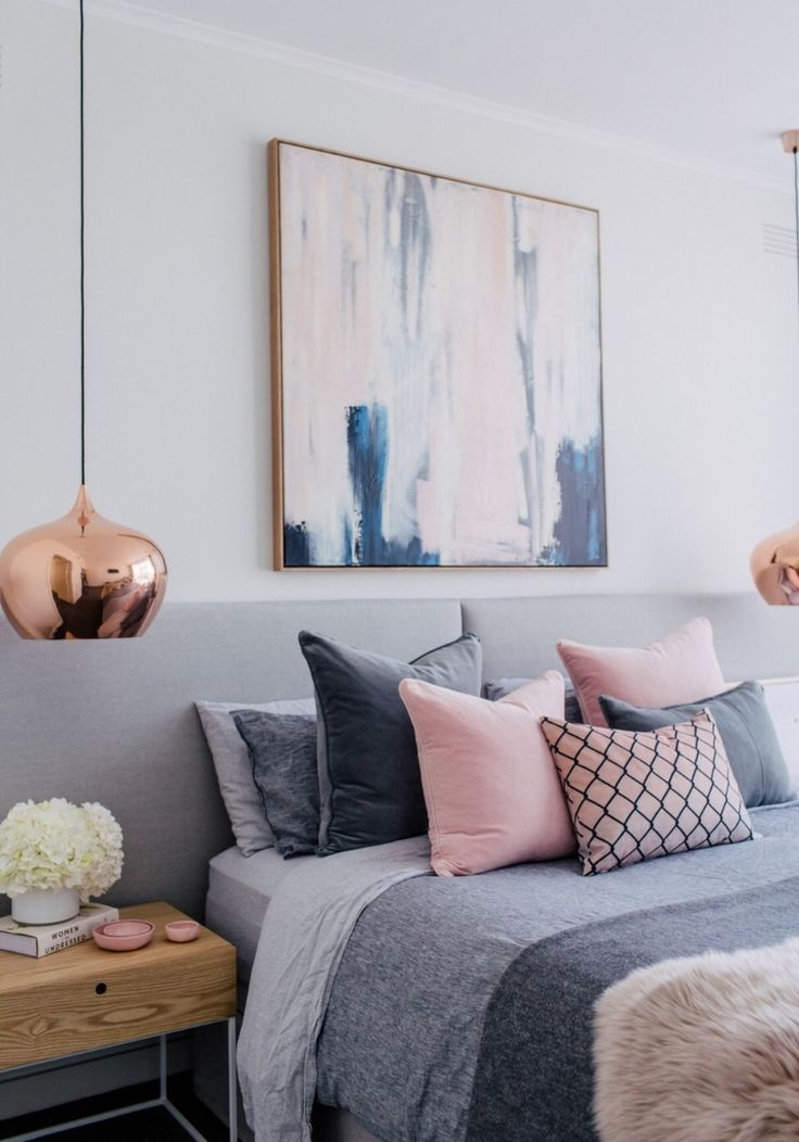 Bedroom inspiration for a great and pink Blush scheme with copper, textures and coloured cushion in grey, pink and pattern. Amazing artwork above the bed.
