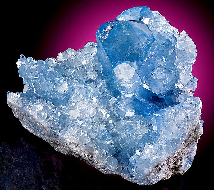 Gemmy and extremely flashy blue cluster of Celestite crystals on matrix!  From the Sakoany Mine, Majunga, Madagascar.