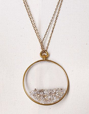 crystal locket filled with loose diamonds