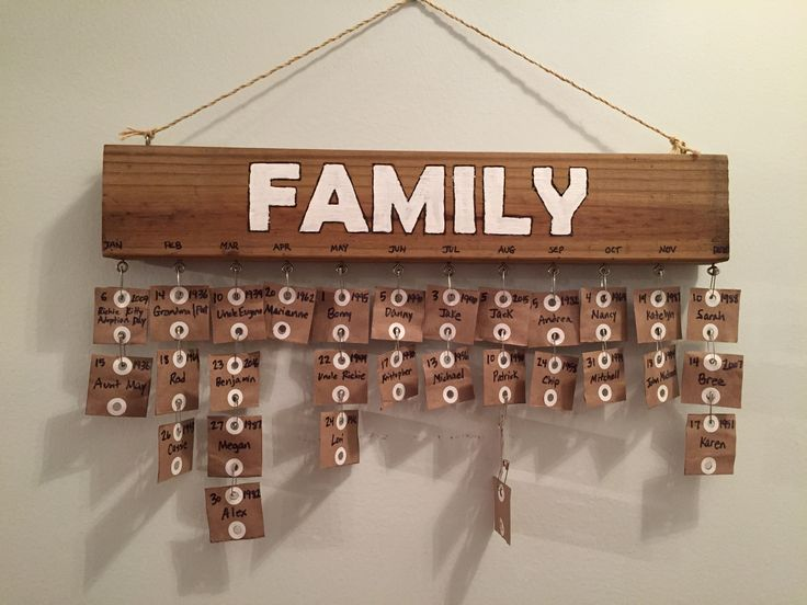 """Keep track of birthdays with all repurposed materials - paper bag tags, 2""""x4"""", safety pins.  Doesn't need much wall space either!"""