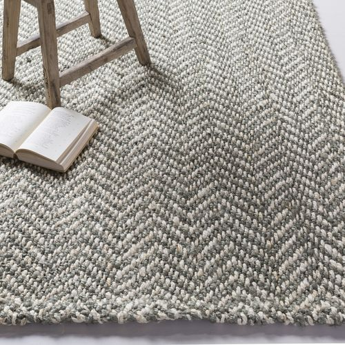 Unique Herringbone pattern is created with this all natural area rug in overlapping woven gray and beige jute fibers.