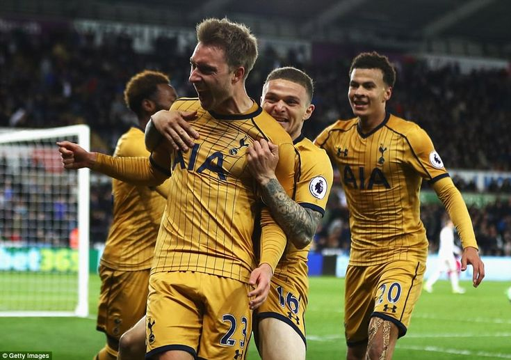 Eriksen is hugged by Kieran Trippier after the Danish midfielder waltzed through the middle of Swansea's defence to score