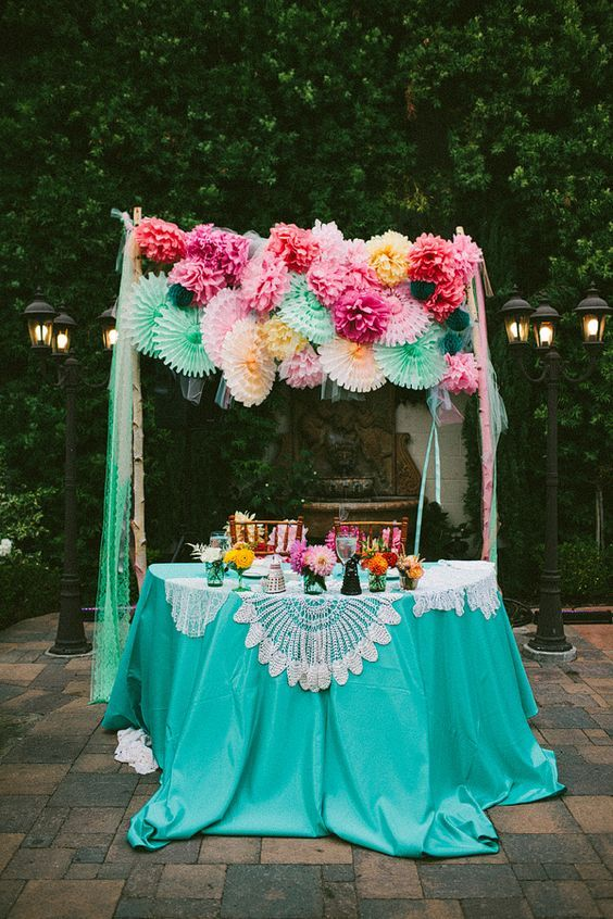 pink mint festive wedding arch / http://www.himisspuff.com/colorful-mexican-festive-wedding-ideas/