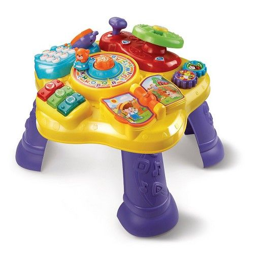 Alice  The Magic Star Learning Table™ by VTech® features six fun activities in English and Spanish that encourage your child to explore and learn. Turn the steering wheel to drive the bear around the activity table, flip the book page to hear nursery rhymes and turn the gears to strengthen fine motor skills. Press the light-up music buttons to play music and learn about colors. Then, pick up the pretend phone and press the number buttons to call animal friends. Remove the legs, and...