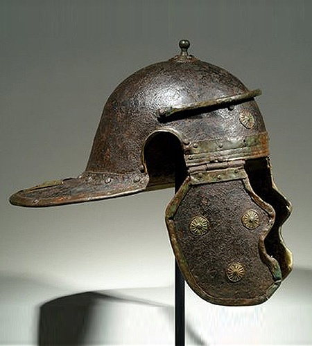 ROMAN Legionary iron and bronze helmet of the Mainz- Weisenau type (side view). Many of the appliques had a purpose other than decorative: they helped reinforce the helmet and deflect blows.