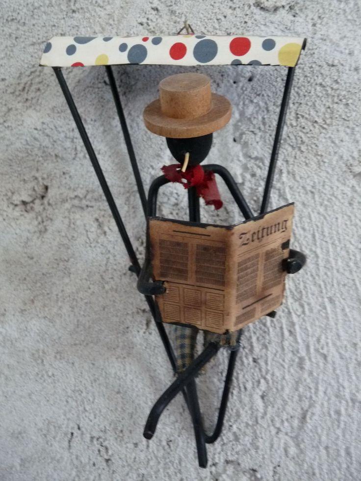 http://www.ebay.de/itm/Schone-seltene-Zeitungsleser-Figur-aus-Stahldraht-50-60Jahre-als-Wanddeko-/271841766686?pt=LH_DefaultDomain_77
