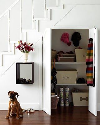 If the space under staircase has a decent depth to it, make it into a smart little closet. Work with the shape and add high shelves and maximize the storage potential. Love this hidden storage surprise!