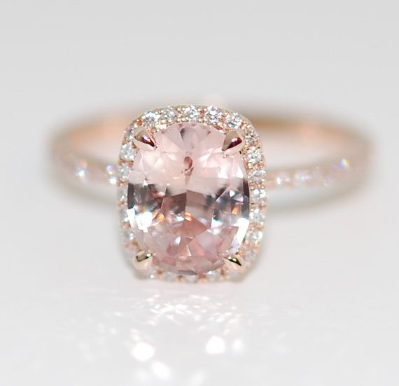 This ring features a 1.8ct cushion sapphire. The stone is unbelievable - clear and beautiful, SI. It is a natural non-treated stone, very rare. The color is pastel peachy champagne - a perfect combination of rose and beige. Very pretty! This beauty is set in a 14k rose gold diamond setting, TDW 0.25ct, SI/H. Size 6, can be resized This ring is ready to ship. USPS priority to the US takes 2-3 business days. DHL to Europe takes 3-5 business days. Shipping within Canada takes 1-3 business...