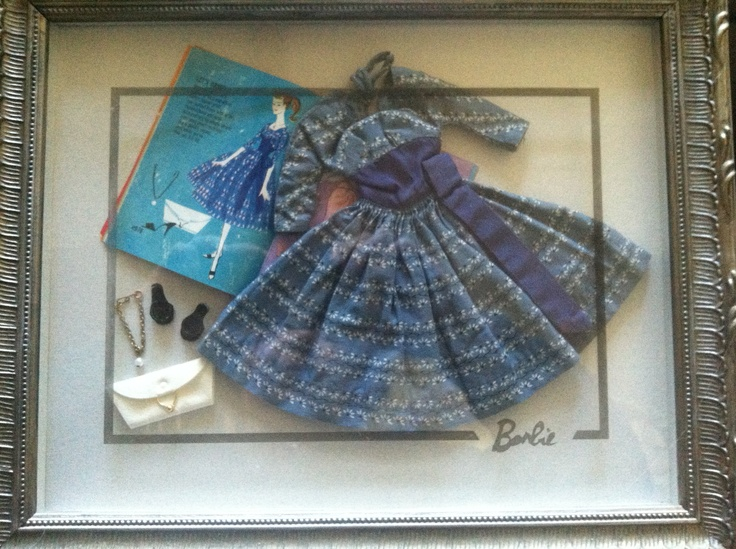 Take your Barbie outfits out of storage and display them.  I use conservation methods that will not harm items.  This one has an etched glass frame