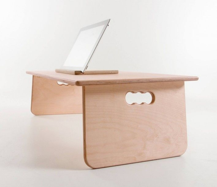 Fold Laptop Table by Bee9.  Ergonomically developed to make working and relaxing sat on a bed, sofa or at a desk more comfortable.  The Fold table raises your work surface and has a slight tilt to create an ideal surface to work on and works great for books, notepads, laptops and tablets.   Portable and easy to store, the Fold desk can be kept out of sight in the narrowest spaces until it is needed.