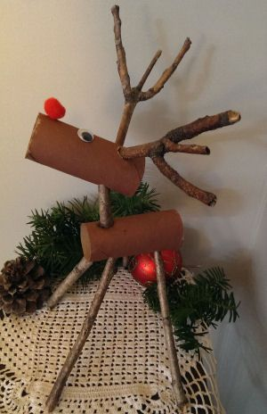 Gather tree branches and empty toilet paper rolls to make this keepsake reindeer craft. An easy Christmas craft for kids to make!