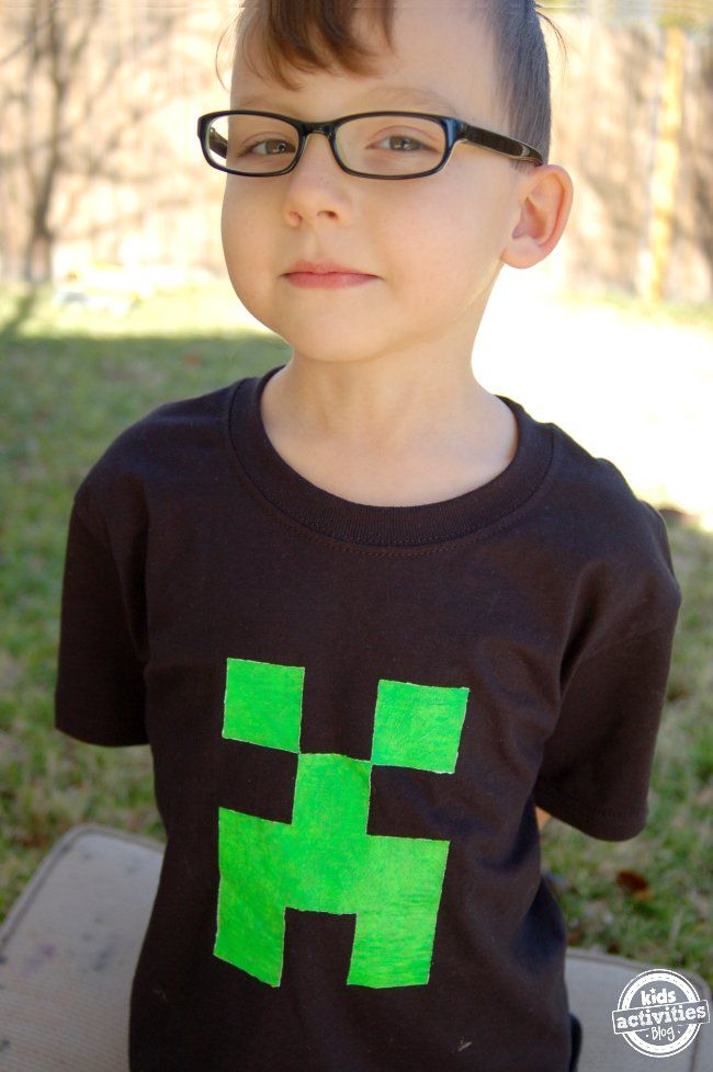 Make a Minecraft T-Shirt featuring a Creeper! This easy craft for kids uses glow-in-the-dark fabric paint for wearable fun.