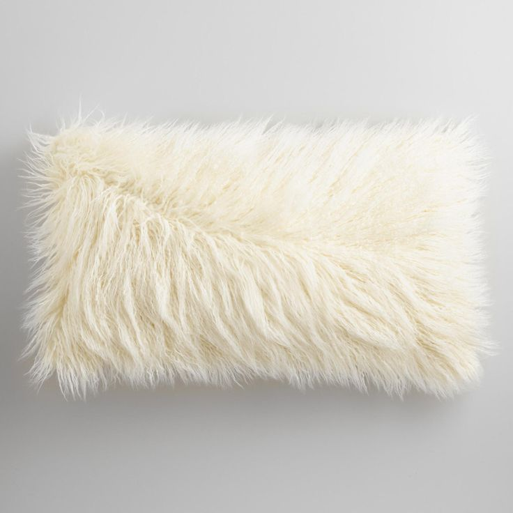 $25- Crafted of fluffy faux Mongolian sheepskin, our inviting ivory pillow lends a lush, luxurious feel to any sofa or chair.