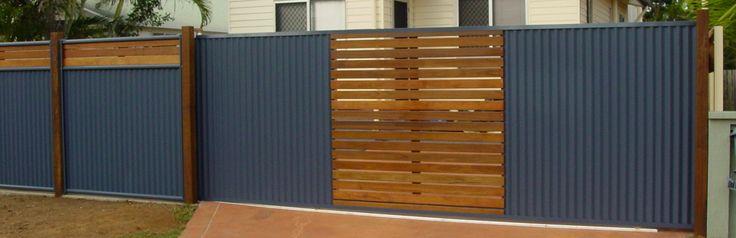 Modern automatic gate - wood and corrugated iron painted blue #gate #automaticgate #residentialgate #metalandwood #slidinggate