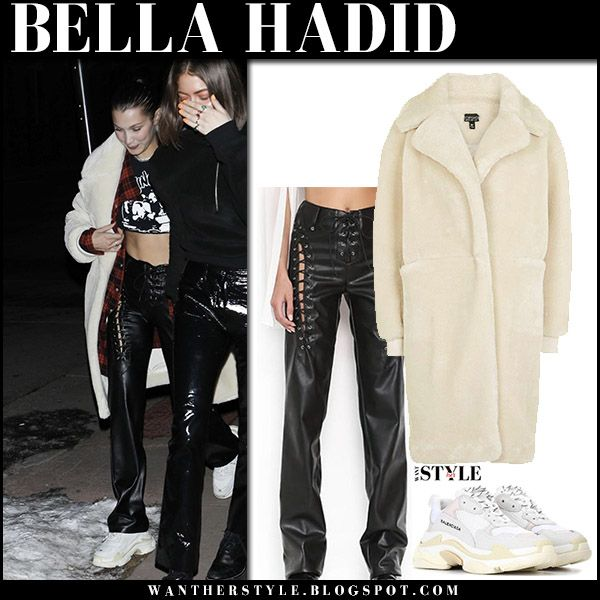 Bella Hadid in cream faux fur coat, black leather pants and white sneakers