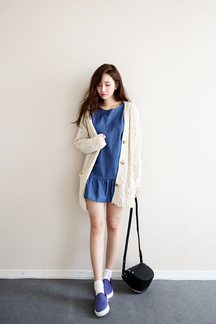 Long knitted cardigan over cute denim dress styled with black clutch and simple shoes.