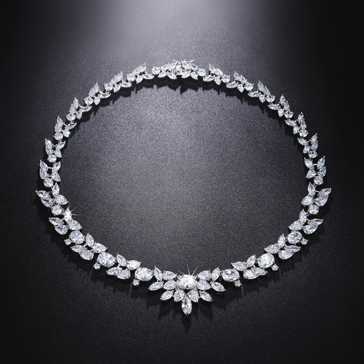 This beautiful cubic zirconia diamond necklace is individually handcrafted with sparkling marquise cut cz diamond setting. We use top grade AAA swiss-made CZ, the necklace is eco-friendly and does not contain lead, nickel or cadmium. It features high quality white gold rhodium plating for tarnish resistance and a long lasting mirror finish.  Free matching CZ earrings included.