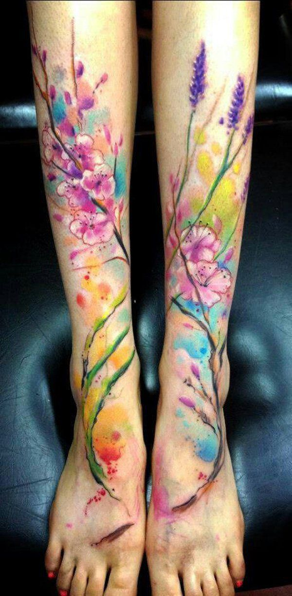 Cherry blossoms and lavender with colorful leg tattoo - Watercolor tattoo. One of the new trends in tattoo art, but loved by many already. Watercolor tattoo style prefers both girls and guys. Often, these tattoos created with a bright shades of pink, blue, yellow, green, etc. As for the sketch, it can be everything from beautiful flowers to romantic flocks of birds and animal portraits.