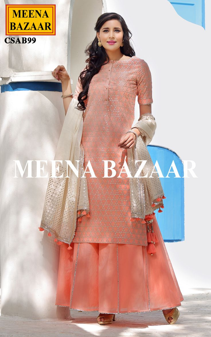 A mesmerizing creation for the up market ladies, this peach cotton sharara suit will bring out the fashionista in you. Featuring zari embroidery all over with metallic button on neckline. It is paired with matching chanderi dupatta with banarasi fabric on border and chanderi sharara having gota on edging.