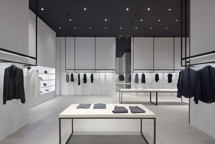 """From DesignFaves. (via inspiration-now.com/) """"Famous design firm Nendo has teamed up with clothing brand Theory and recently completed two high-end stores in L.A. The store's design was based heavily on consumer research and the clothing brands mission philosophy. The finished product is an ultra-modern and minimal look with a logical circulatory shopping style."""""""