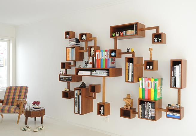 just plain fun and funky #shelves. And don't miss that sweet little log table beside the chair.