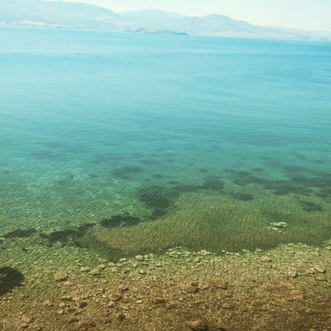 The beautiful and colorful daylight waters near the harbor of Molyvos (Lesvos, Greece)