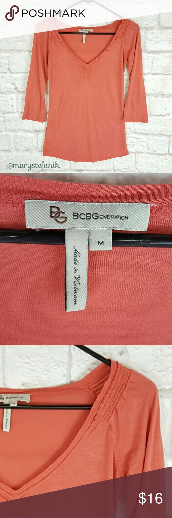 "BCBGeneration 3/4 Sleeve Coral Tee T Shirt size M BCBGeneration 3/4 Sleeve Coral Tee T Shirt size M in excellent used condition. Slightly sheer. Form fitting. Soft and stretchy. 60% Rayon and 40% Acrylic.   Waist from Seam to Seam: 15"" Length from Top: 24""  Please let me know if you have any questions. Happy Poshing! BCBGeneration Tops Tees - Long Sleeve"