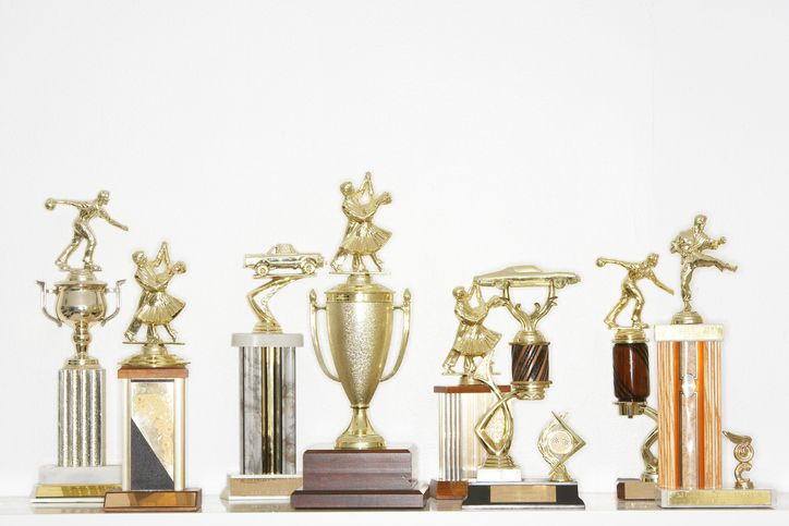 Trophies. Crafters repurpose trophies into everything from bottle stoppers to cake toppers, no surprise that a large one can get $40 on eBay.