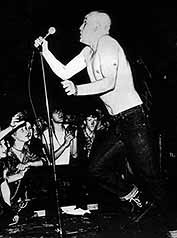 Thomas (Mensi) Mensforth fronting The Angelic Upstarts: 'All you kids, black & white/Together we are dynamite,' Kids in the Street, 1981