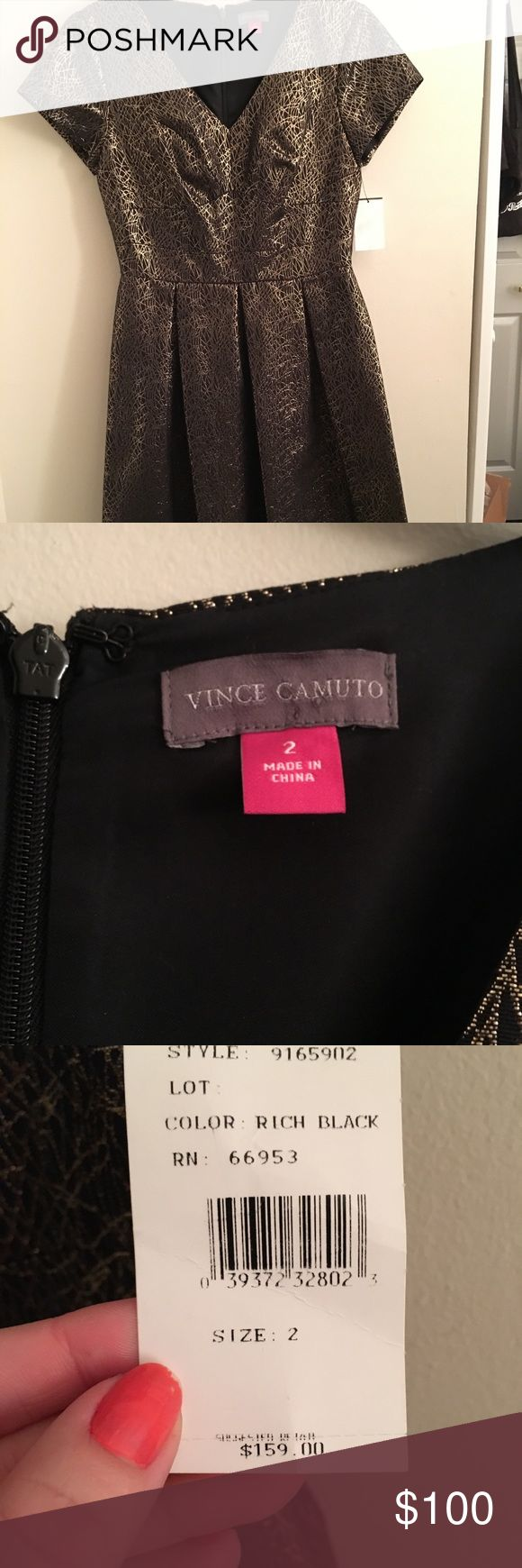 NWT Vince Camuto Gold Shimmer Dress Beautiful black dress with a unique golden design patterned throughout. Back zipper and has a V neck.  51% Cotton, 36% Polyester, 13% Metallic Imported Dry Clean Only Back zip closure Invisible zipper Is lined Vince Camuto Dresses Mini