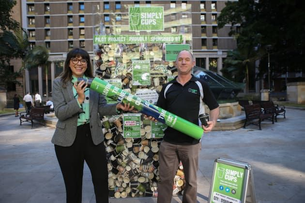 The coffee cups collected as part of the trial were on display at Wynyard Park, Sydney. City of Sydney Cr Jess Scully is pictured here with Brendan Lee of Closed Loop Environmental Solutions.