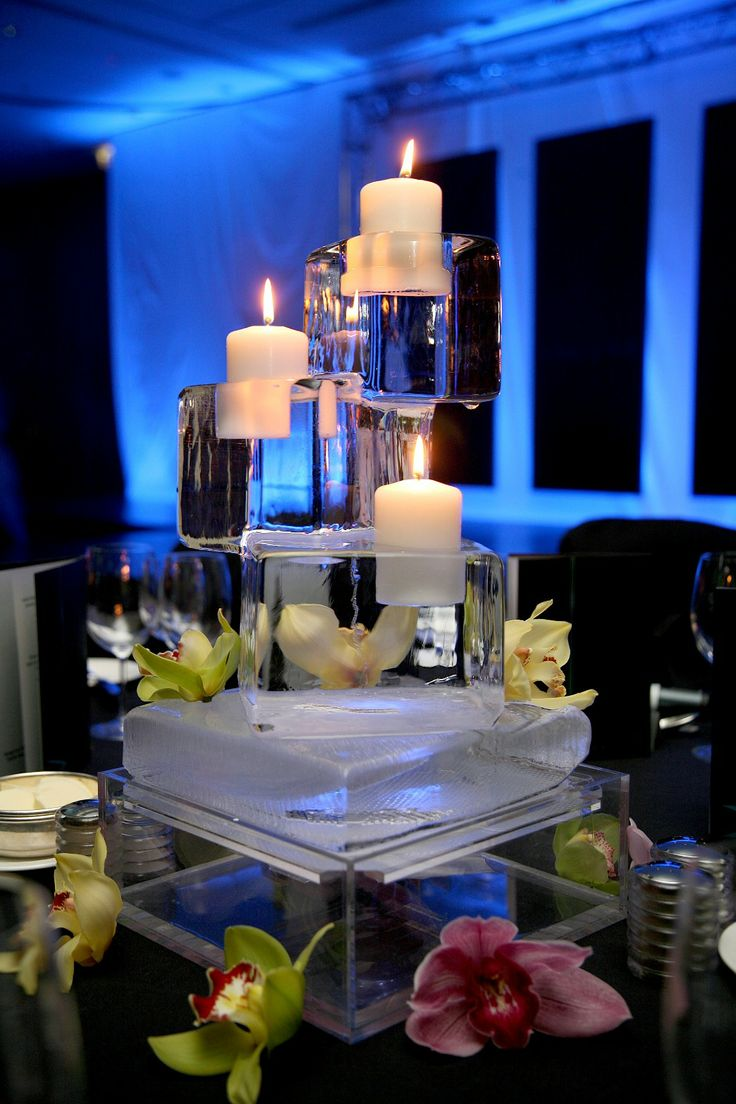 Ice sculptures as centerpieces with candles adds a unique