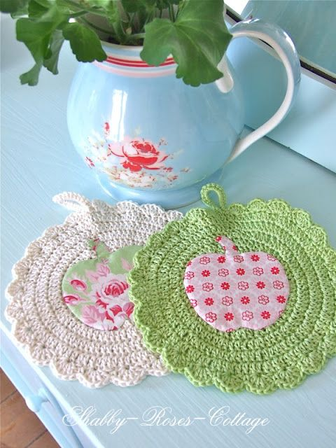 Crochet potholders with appliqué.  Love the sweet vintage feel.  Would be darling with red and turquoise or red and black, too!  :-)
