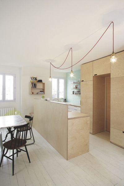 Cuisine ouverte bois dans un espace très lumineux