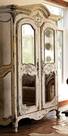 Wonderfully aged and distressed wardrobe with modern mirror insertions. A great addition to any guest room
