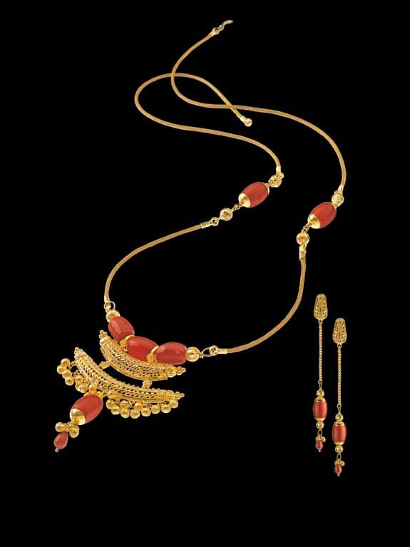 Jugal Bandi Necklace : A duet of gold and fire-red corals, this ultra light casual necklace carries the charm of a mangal-sutra but it works equally as an ornament for festive occasions.