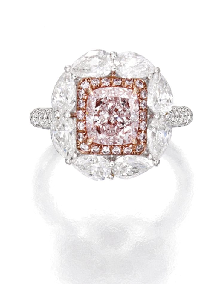 18 KARAT TWO-COLOR GOLD,LIGHT PINKDIAMOND AND DIAMOND RING. Centered by a cushion-cut Light Pink diamond weighing 1.52 carats, framed by small round diamonds of pink hue weighing .51 carat, bordered and accented by round and pear-shaped diamonds weighing 2.32 carats