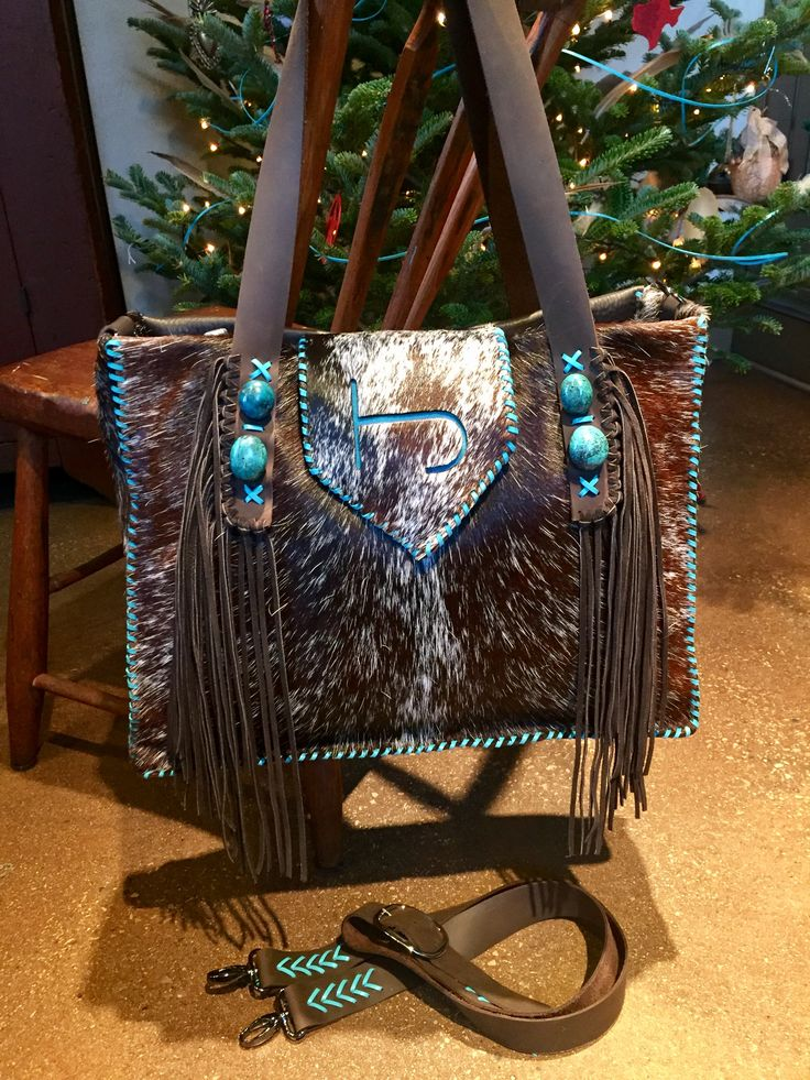 The Buckaroo Diaper Tote, with the owners brand in turquoise suede, hand cut fringe and turquoise stones. Custom purses and totes from gowestdesigns.us