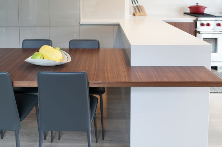 Modern table built-into this kitchen peninsula creates a great flow of space between the dining room and kitchen by Hans Krug