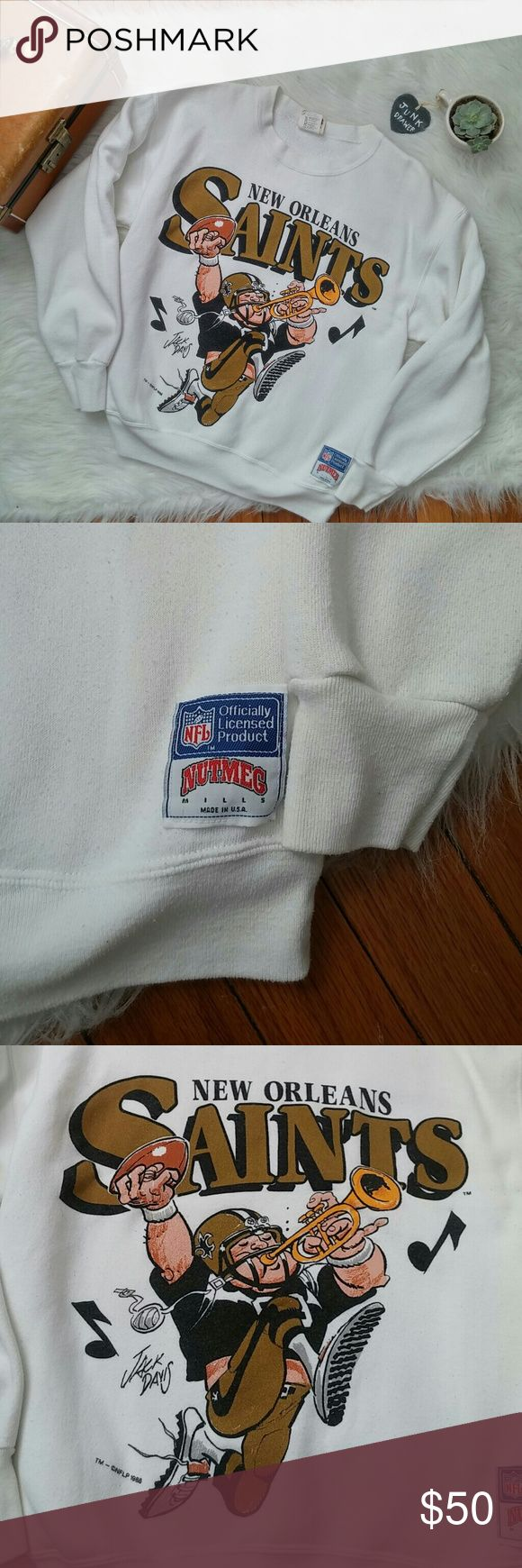 """Vintage 80s New Orleans Saints Sweatshirt Lg Worn but great vintage condition. Some pilling. Very minor unnoticeable staining pictured. Jack Davis Artwork. NFL licensed product. Nutmeg Mills. Made in USA. Cotton/polyester. Bust 22"""". Length 24.5"""".  BUNDLE your likes and shoot me and OFFER! Glad to negotiate. Hundreds of items available for discounted bundle offers!  Follow on IG: @the.junk.drawer Vintage Tops Sweatshirts & Hoodies"""