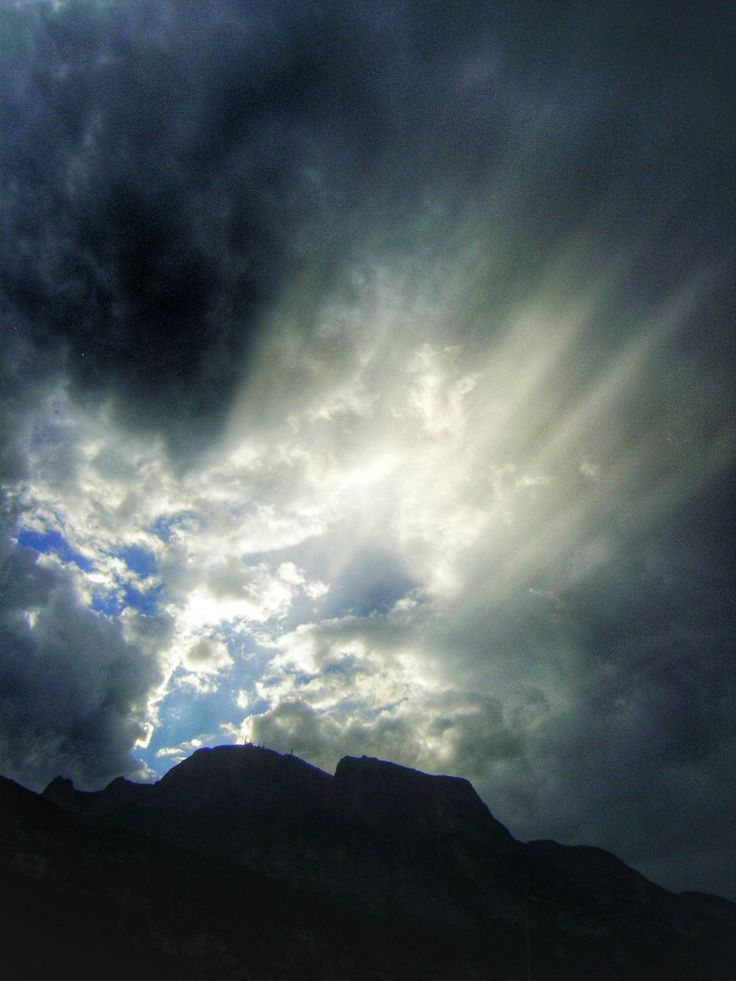 sky, cloud - sky, tranquil scene, scenics, tranquility, mountain, cloudy, beauty in nature, silhouette, nature, mountain range, weather, cloud, overcast, landscape, low angle view, cloudscape, idyllic, dusk, storm cloud