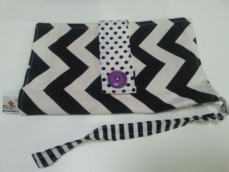 Black, white and purple..  Diaper pouch made by Bilbuli