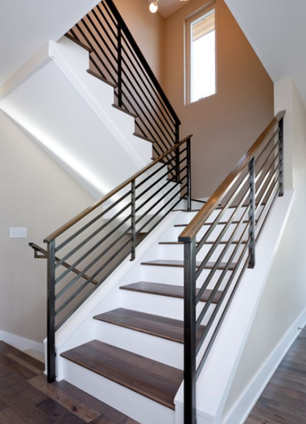 A simple and stylish way to make the staircase look simple yet chic and eye-catching is to use contrasts. In this case, for example, the wooden stairs sit on a crisp white background and the metal guardrail with wooden handrail frame them beautifully.