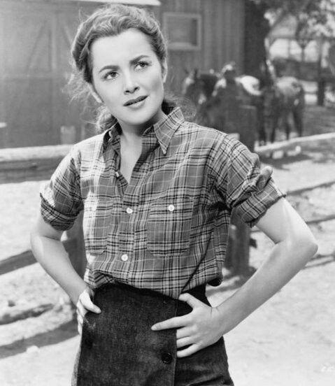 Olivia de Havilland as Kit Carson Holliday on the set of Santa Fe Trail (1940).