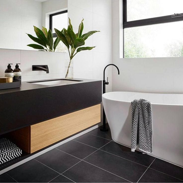 R U S H ➕ V I V I D S L I M L I N E We absolutely love the black, white and timber styling in this stunning ensuite in The Langham 44 house from @cartergrangehomes ! This bathroom features our Rush Wall Set and Vivid Slimline Floor Mounted Bath Mixer, both in ONIX Matte Black ⏩ check out our website for details!