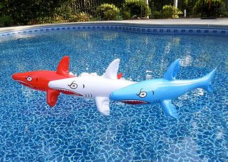 A set of three inflatable sharks were used for shark party decorations and for some fun swimming pool games.
