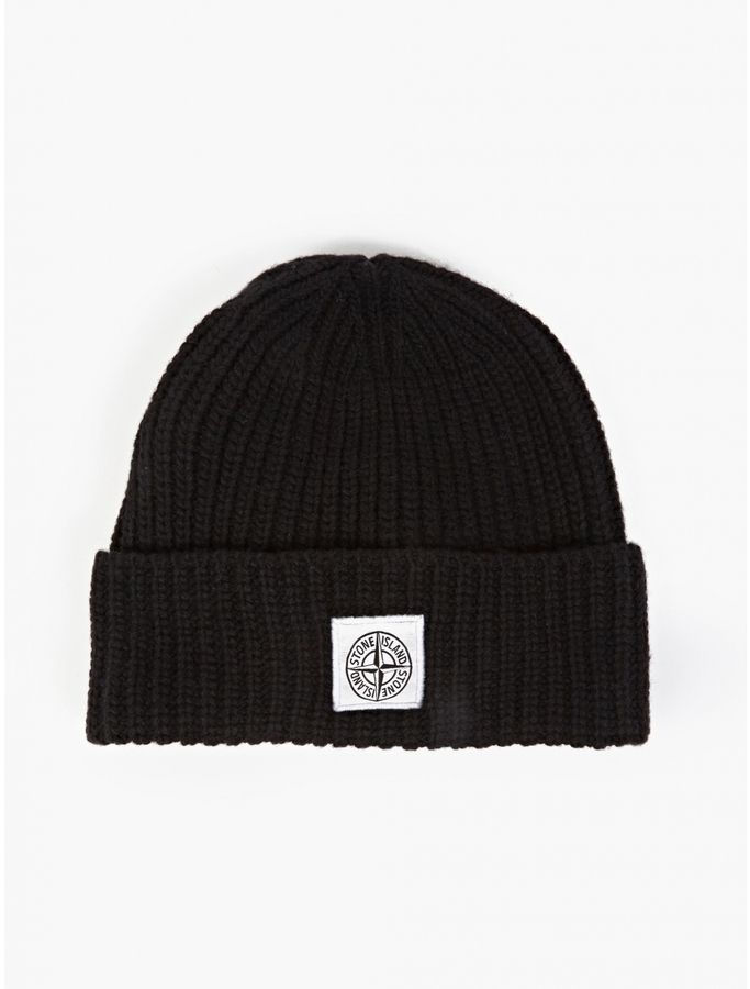 $116, Black Beanie: Stone Island Black Ribbed Beanie Hat. Sold by oki-ni. Click for more info: https://lookastic.com/men/shop_items/318390/redirect